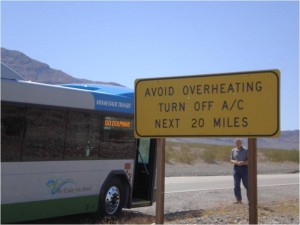Death Valley climate testing, sign reads avoid over-heating, turn off a/c, next 20 miles
